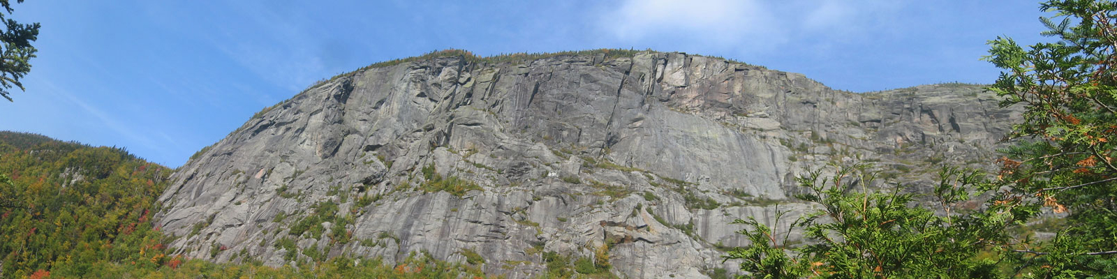 Sheer cliff seen from below