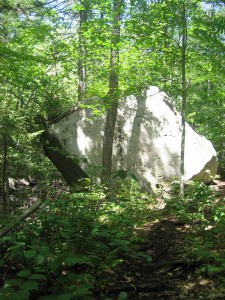Large angular boulder beside the trail