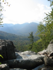 Top of Roaring Brook Falls with high peaks in the background