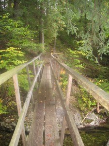 Crossing the wooden bridge along the trail