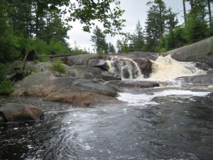 Pool of water and frothy cascade known as High Falls
