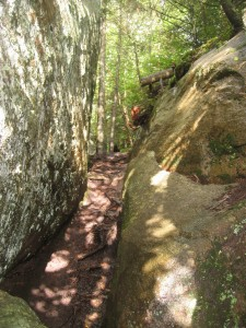 Narrow passage between two large boulders