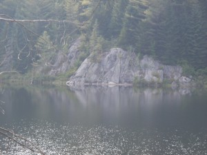Rock outcropping seen across Mud Pond
