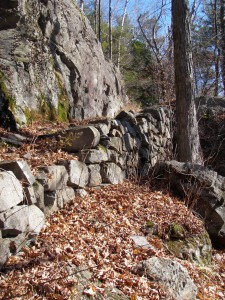 Rock wall that forms switchback along trail