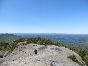 Bald mountain top with hikers descending