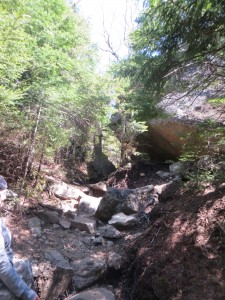 Narrow passage between two large formations near Ampersand Mountain summit